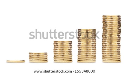 Coins lined up from short to tall stacks - stock photo