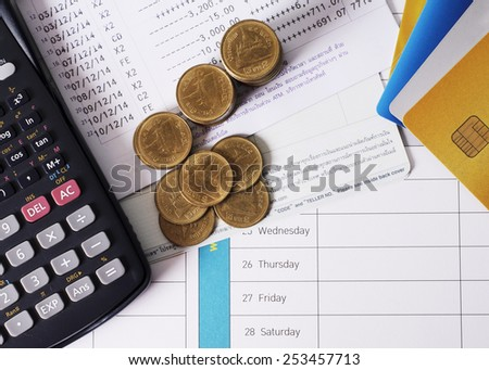 Coins money and calculator and credit card for loan money concept
