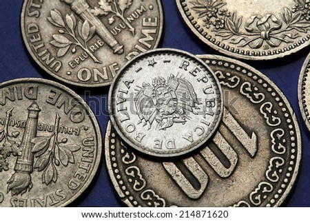 Coins of Bolivia. Bolivian national coat of arms depicted in Bolivian two centavos coin. - stock photo