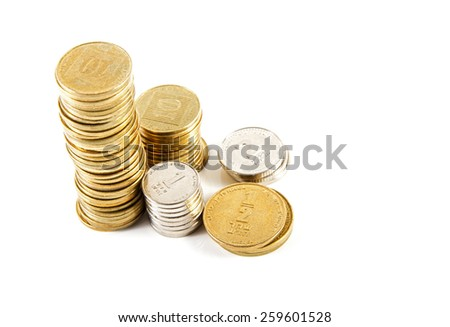Coins of different denominations Israeli bank against white background . - stock photo