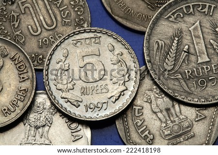 Coins of India. Floral motif depicted in the Indian five rupees coin. - stock photo