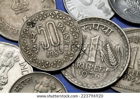Coins of India. Indian one rupee and fifty paise coins. - stock photo