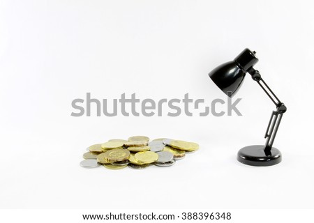Coins of Malaysia ang black mini led desk lamp isolated on white background - stock photo