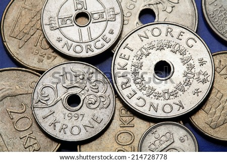 Coins of Norway. Fowl bird depicted in Norwegian one krone coin and Norwegian five kroner coin.  - stock photo