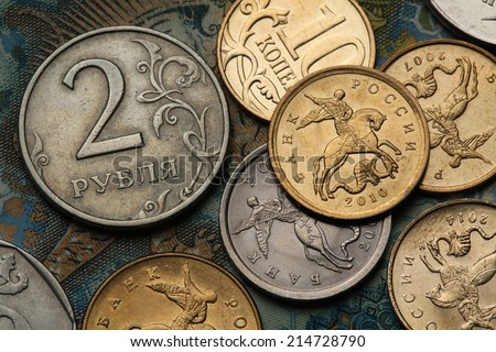 Coins of Russia. Saint George killing the Dragon depicted in Russian kopek coins and Russian two roubles coin. - stock photo