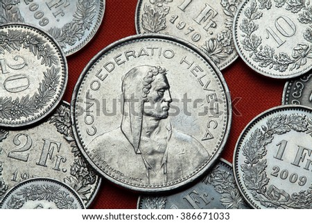 Coins of Switzerland. Alpine herdsmen depicted in the Swiss five franc coin.