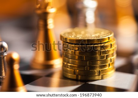 Coins on a chess board. Finance concept. - stock photo