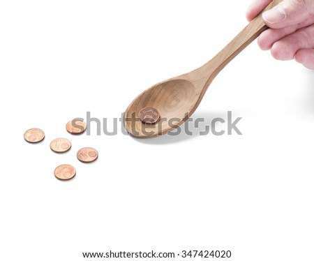 Coins on a wooden spoon. Saving money for you - stock photo