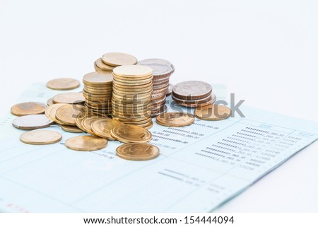 coins on bank account book - stock photo