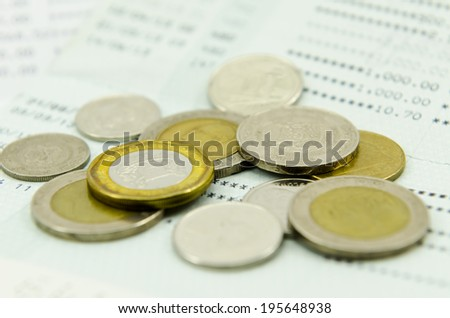 Coins on bank statement - stock photo