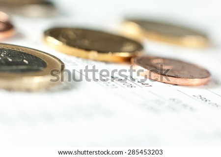 Coins on financial report.