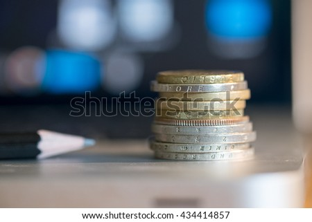 coins on laptop