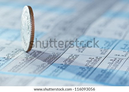 Coins on stock index background