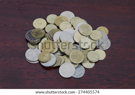 coins on the dark wood table. close-up - stock photo