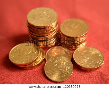 Coins over red background - stock photo