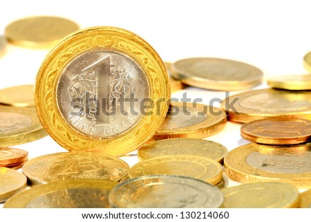 Coins over white background - stock photo