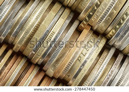 Coins shown up close, forms the background - stock photo