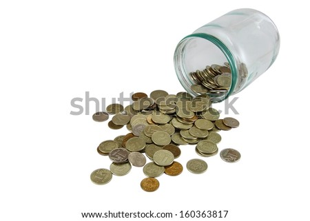 Coins spill out of the glass jar