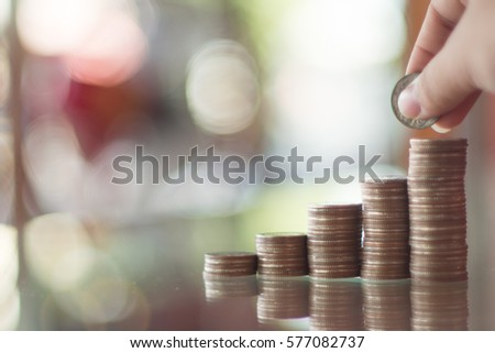 Coins stack saving money blurry background