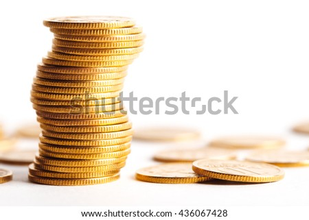 Coins stacked on each other in different positions. Money concept. - stock photo