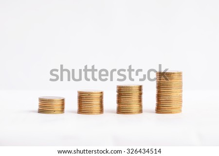 coins stacked up in a row, on white background