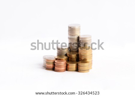 coins stacked up, on white background