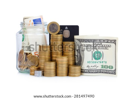 Coins stacks with paper currency and glass jar full or bills and coins with credit card isolated on white - stock photo