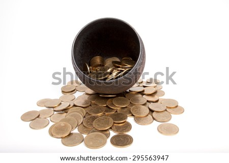 coins thai baht in Earthen jar on white background