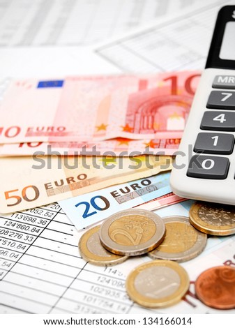 Coins, the calculator . - stock photo