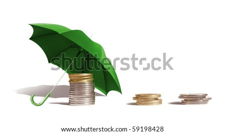 Coins under an umbrella on a white background. - stock photo