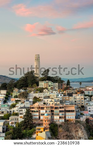 Coit Tower atop Telegraph Hill at sunset in San Francisco, California. - stock photo