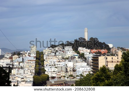 Coit Tower in San Francisco seen from afar - stock photo