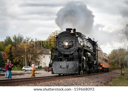 COKATO MN - OCTOBER 12: Fall colors excursion of the Milwaukee Road #261 Steam Engine from Minneapolis, MN to Willmar, MN. Train is greeted by fans on October 12, 2013 in Cokato MN