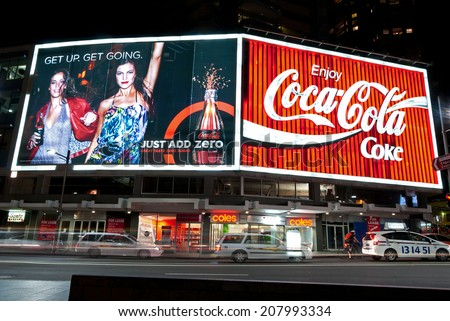 Coke billboards in Kings Cross, Sydney, AU, 29th June 2014. The Coca-Cola advertising billboards at the intersection of William St. and Darlinghurst Road in Sydney. - stock photo