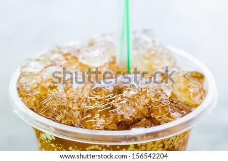 Coke in plastic glass - stock photo