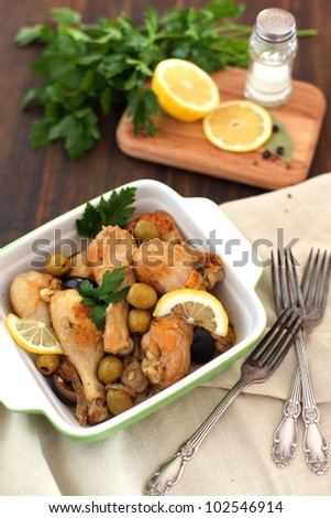 Coked Moroccan chicken in a bowl, served with forks