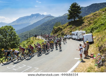 COL D'ASPIN,FRANCE - JUL 15: The peloton climbing the road to Col D'Aspin in Pyrenees during the stage 11 of Le Tour de France on July 15, 2015.