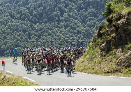 COL D'ASPIN,FRANCE - JUL 15: The peloton climbing the road to Col D'Aspin  in Pyrenees Mountains during the stage 11 of Le Tour de France on July 15, 2015. - stock photo