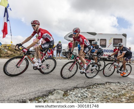 COL DE LA CROIX DE FER, FRANCE - JULY 25: Group of cyclists (including Sieberg and Greipel of Lotto-Soudal ) riding to the Col de la Croix de Fer during  Le Tour de France on July 25, 2015.  - stock photo