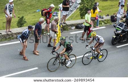 COL DE PEYRESOURDE,FRANCE-JUL 23: Cyril Gautier (Europcar), and Blel Kadri (Ag2r-La Mondiale) climbing the road to Col de Peyresourde during the stage 17 of Le Tour de France on 23 July 2014. - stock photo