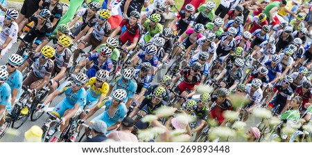 COL DE PEYRESOURDE,FRANCE-JUL 23: Upper view of the peloton climbing the road to Col de Peyresourde in Pyrenees Mountains during the stage 17 of Le Tour de France on 23 July 2014. - stock photo