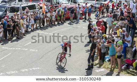 COL DU GLANDON, FRANCE - JUL 23: Bob Jungels of Trek Factory Racing Team riding in a beautiful curve at Col du Glandon in Alps during the stage 18 of Le Tour de France on July 23, 2015. - stock photo