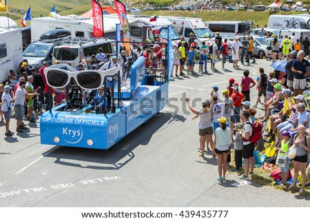 COL DU GLANDON, FRANCE - JUL 23:  Krys vehicle during the passing of the Publicity Caravan on the road to Col du Glandon in Alps during the stage 18 of Le Tour de France on July 23, 2015.