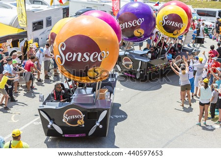 COL DU GLANDON, FRANCE - JUL 23:Senseo caravan during the passing of the Publicity Caravan on the road to Col du Glandon in Alps in the stage 18 of Le Tour de France on July 23, 2015