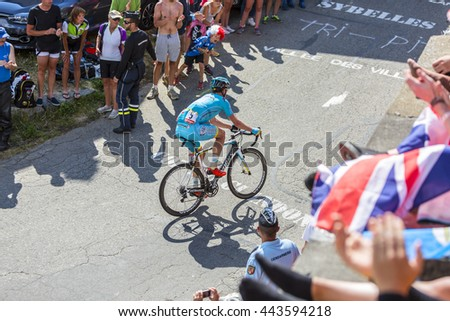 COL DU GLANDON, FRANCE - JUL 23:The Kazakh cyclist Dmitriy Gruzdev of Astana Team riding on the road to Col du Glandon during the stage 18 of Le Tour de France on July 23, 2015