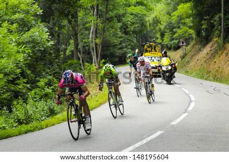 COL DU GLANDON, FRANCE - JULY 19,  - Tour de France racers descend the Col du Glandon during stage 19 on July 19, 2013. - stock photo
