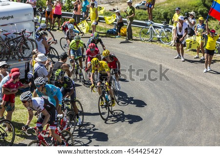 COL DU GRAND COLOMBIER,FRANCE-JUL 17: Group of important cyclists with Froome in Yellow Jersey, riding on the road to Col du Grand Colombier in Jura Mountains in the stage 15 of Tour de France 2016.