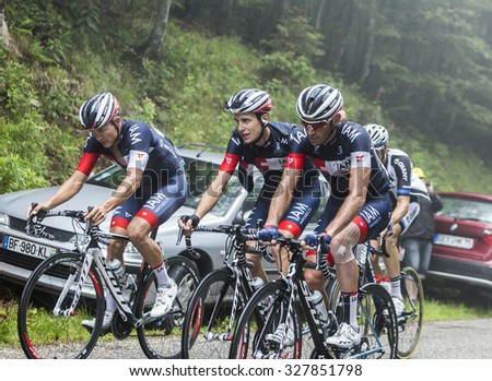 COL DU PLATZERWASEL,FRANCE - JUL 14: Group of three cyclists of IAM Cycling Team riding on the climbing road to mountain pass Platzerwasel in Vosges Mountains, during Le Tour de France on July 14 2014