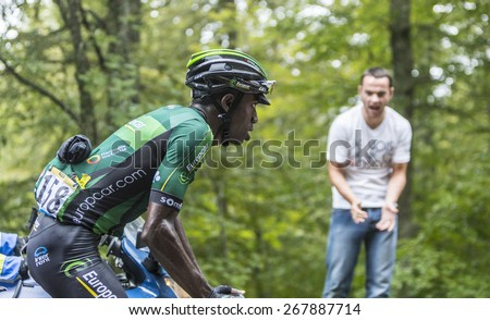COL DU PLATZERWASEL,FRANCE - JUL 14:The cyclist Kevin Reza of Europcar Team, climbing the mountain pass Platzerwasel in Vosges Mountains during the stage 10 of Le Tour de France on July 14 2014 - stock photo