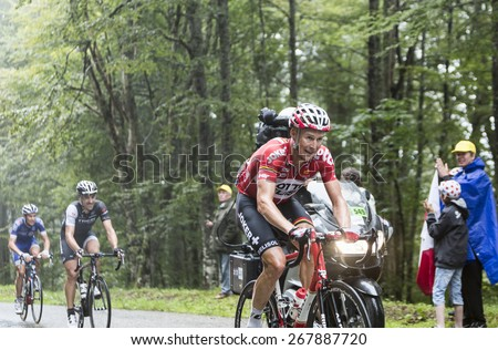 COL DU PLATZERWASEL,FRANCE - JUL 14: The cyclist Lars Bak of Lotto Belisol Team, climbing the mountain pass Platzerwasel in Vosges Mountains during the stage 10 of Le Tour de France on July 14 2014 - stock photo